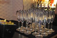 Champagne glasses on the bar Royalty Free Stock Images