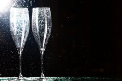 Champagne glasses on black spray Royalty Free Stock Images