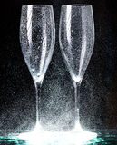 Champagne glasses on black spray Royalty Free Stock Image