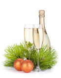 Champagne glasses, bottle, baubles and fir tree Royalty Free Stock Images