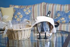 Champagne glasses and bottle in hotel suite Stock Photography