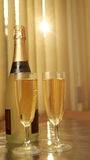 Champagne in glasses and the bottle. Stock Photo
