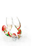 Champagne glasses with bows. Wine glasses with red and green ribbons on white Stock Photography