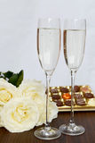 Champagne Glasses, Box of Chocolate and Bunch of White Roses Royalty Free Stock Photography