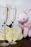 Champagne Glasses, Box of Chocolate, Bunch of White Roses and Pi Stock Photos