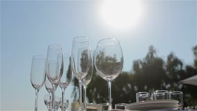 Champagne glasses on the buffet table, the hall of the restaurant or hotel, the stock footage