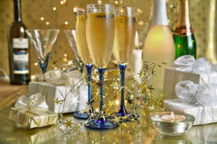 Champagne in glasses,candle and lights Stock Photos