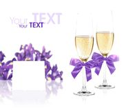 Champagne glasses, card and irises Royalty Free Stock Photo