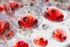 Champagne glasses with cherry. A number of champagne glasses filled with bubbles and cherry stock images