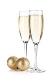 Champagne glasses and christmas balls Royalty Free Stock Photos