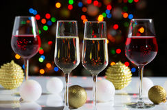 Champagne glasses and christmas balls Stock Photos