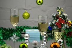 Champagne glasses and christmas balls on snow.  Stock Image