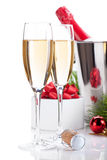 Champagne glasses and christmas decor Royalty Free Stock Photography