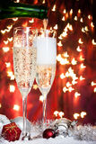 Champagne glasses and christmas decoration Royalty Free Stock Images