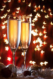 Champagne glasses and christmas decoration Stock Image