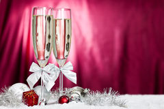 Champagne glasses and christmas decoration. Christmas decoration with christmas ball ornaments and champagne glasses Stock Image