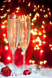 Champagne glasses and christmas decoration Stock Images