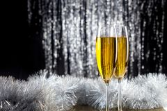 Champagne glasses with christmas decoration. royalty free stock images