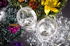 Champagne glasses with christmas decoration. royalty free stock photography