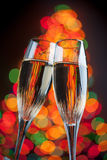 Champagne glasses with christmas lights Royalty Free Stock Image