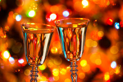 Champagne glasses and Christmas lights Royalty Free Stock Images
