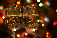 Champagne glasses and Christmas lights Stock Photography