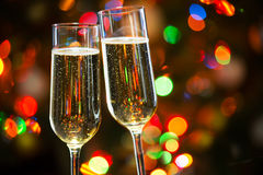 Champagne glasses and Christmas lights Royalty Free Stock Photo