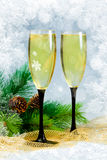 Champagne in glasses and Christmas tree Royalty Free Stock Photos