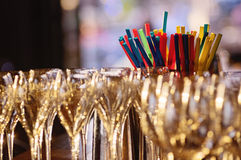 Champagne glasses and cocktail straws Stock Photo