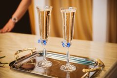 Champagne glasses decorated with blue bow Royalty Free Stock Photography