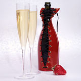 Champagne in glasses with decorated bottle and strawberry Stock Photos
