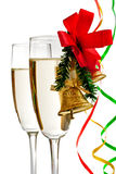 Champagne glasses decorated with Christmas bells Royalty Free Stock Photo