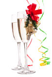 Champagne glasses decorated with Christmas bells Stock Photos