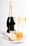 Champagne in glasses and a dessert Stock Image