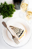 Champagne in glasses and a dessert Royalty Free Stock Photography