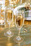 Champagne glasses on the dinner table Stock Photos