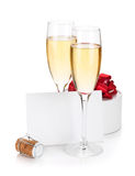 Champagne glasses, empty card and gift Royalty Free Stock Photo