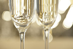 Champagne glasses with engagement Jewelry Royalty Free Stock Photos