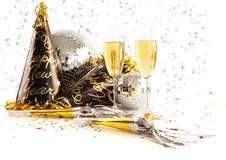 Champagne glasses with festive party hats on white. Background Royalty Free Stock Image