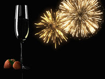 Champagne glasses with fireworks on background Stock Images