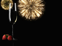Champagne glasses with fireworks on background Royalty Free Stock Photos