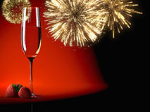 Champagne glasses with fireworks on background Royalty Free Stock Images