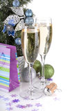 Champagne glasses, firtree and christmas decor Stock Photos