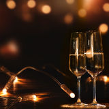Champagne glasses in front of a festive background Royalty Free Stock Image