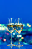 Champagne glasses in front of a window Royalty Free Stock Images