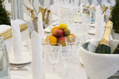 Champagne glasses and fruits Stock Images
