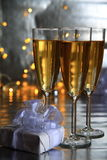 Champagne in glasses and gift box Royalty Free Stock Images