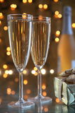 Champagne in glasses and gift box. Royalty Free Stock Images