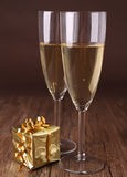 Champagne glasses and gift box Stock Images