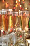 Champagne in glasses, gift box and lights Stock Image